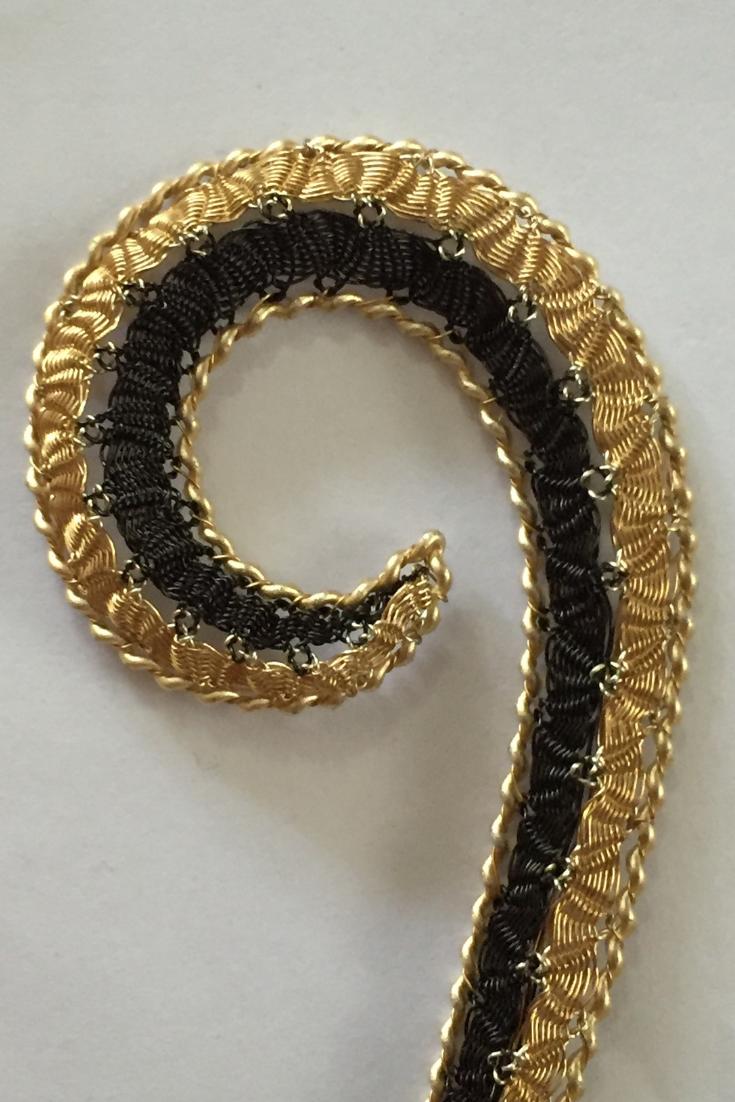 Wire bobbin lace curl by Lauran Sundin