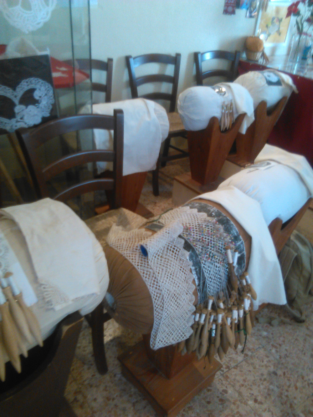 "Lace pillows on their traditional stands at the ""Il Murazzo"" association, Pellestrina, Venice"