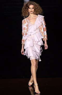 Runway shot with embroidered jacket from Valentino's 2004 couture collection