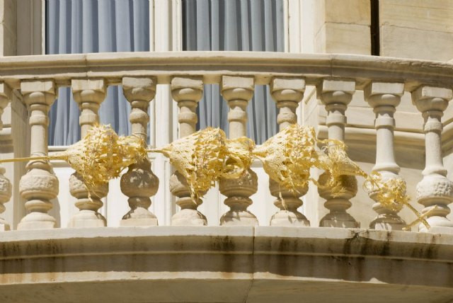 A woven palm decoation on a balcony for the Easter celebrations, Seville