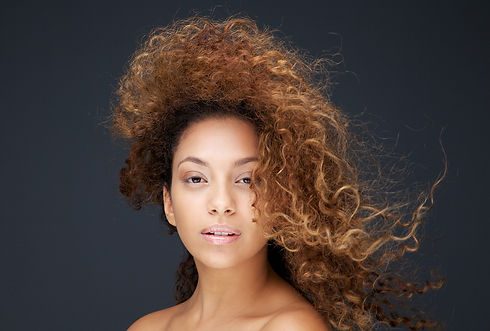 mixed race female with blonde and brown curly hair