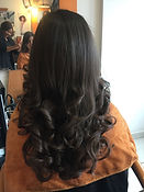 natural black curly hair at hairdresser