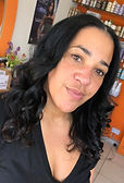 Mixed race female black curly hair at salon