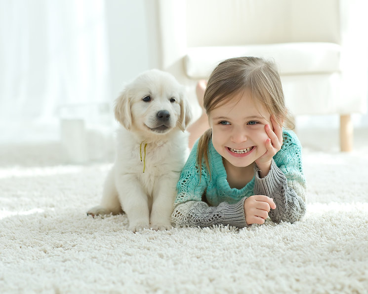 The child with the dog lying on the mat