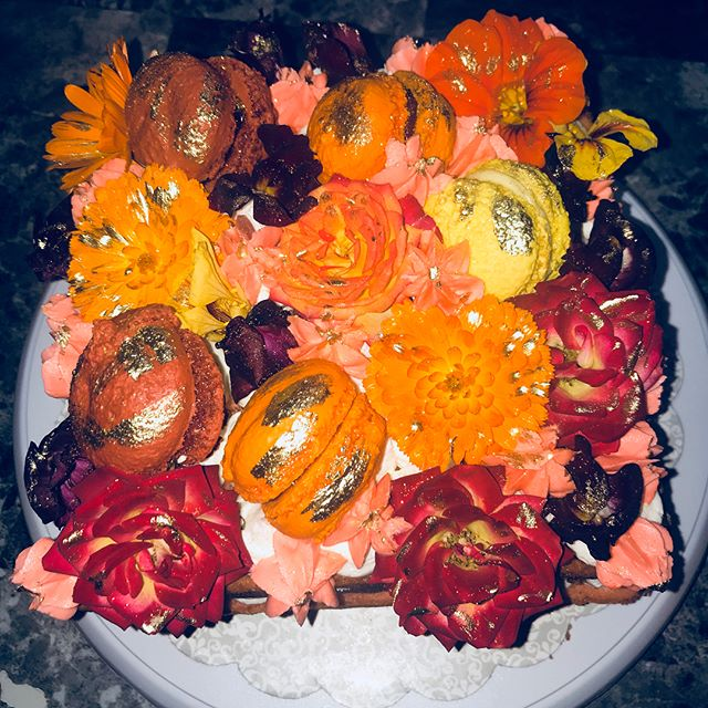 Made with all edible flowers Orange lemon and Raspberry Macrons with A Bavarian Cream filling and Or
