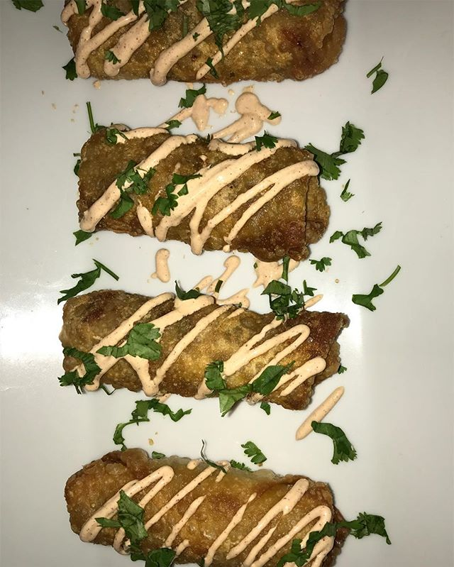 Southwest egg rolls with a chula sour cream (ground turkey black beans corn jalapeño avocado cilantr