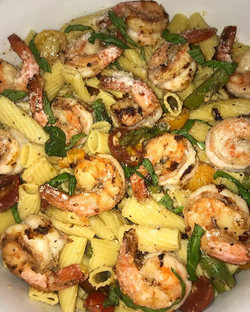 Marinated Shrimp, Asparagus, heirloom tomatoes, tossed in a garlic and oil sauce with rigatoni noodl