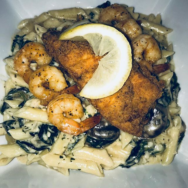 Deep Fried Salmon with Sautéed Shrimp over a spinach mushroom and onion penne Alfredo (always cookin