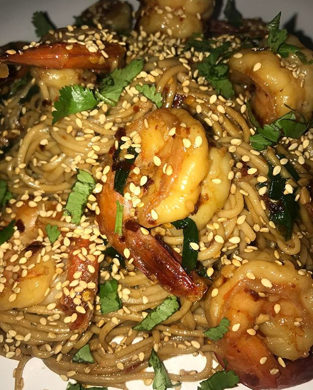 Asian Style Shrimp Scampi over Garlic soba noodles with a cilantro and toasted sesame seed garnish
