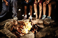 School group camp fire and marshmallows