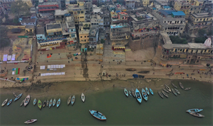 "Here's my drone footage of Dashashwamedh Ghat in Benaras (actually, this is the ""Dhobi"" Ghat). Unfortunately, and perhaps quite naturally, the level of pollution, smoke, and fog created the perfect mix for plummeting visibility; hence, the lackluster colors of the surroundings."