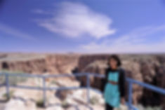 Girl standing in front of the massive vastness of the Grand Canyon. Summer is the best time to visit the park for families and kids, although the temperature during this time could be very high.
