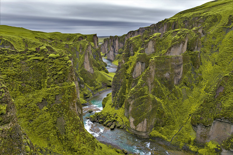 Take a family vacation in Iceland and you'll see the astounding beauty of rivers flowing through mossy canyons