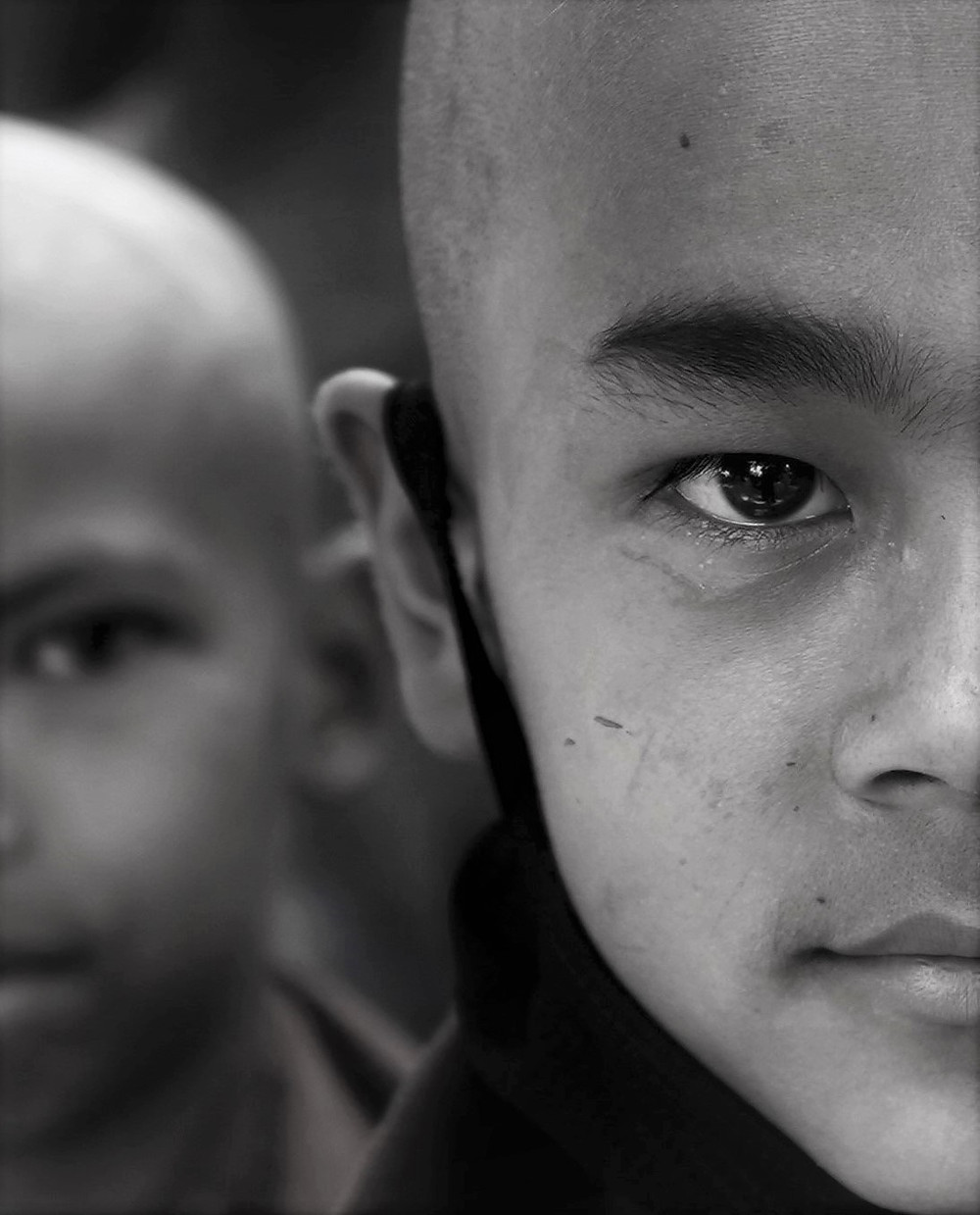 Split screen profile of young monks-to-be who arrived from the dharmashala on the occasion of a visit from the Dalai Lama.