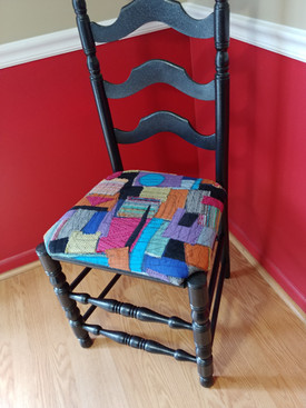 Recoverd chair with scrap fabric