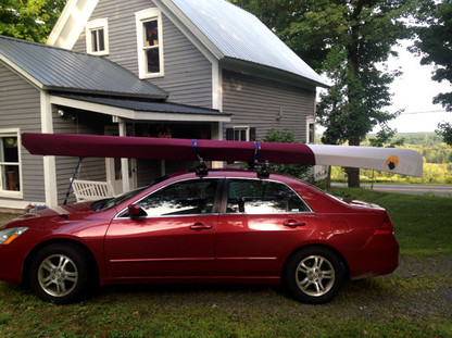 Maroon and white canoe cover with Artwork