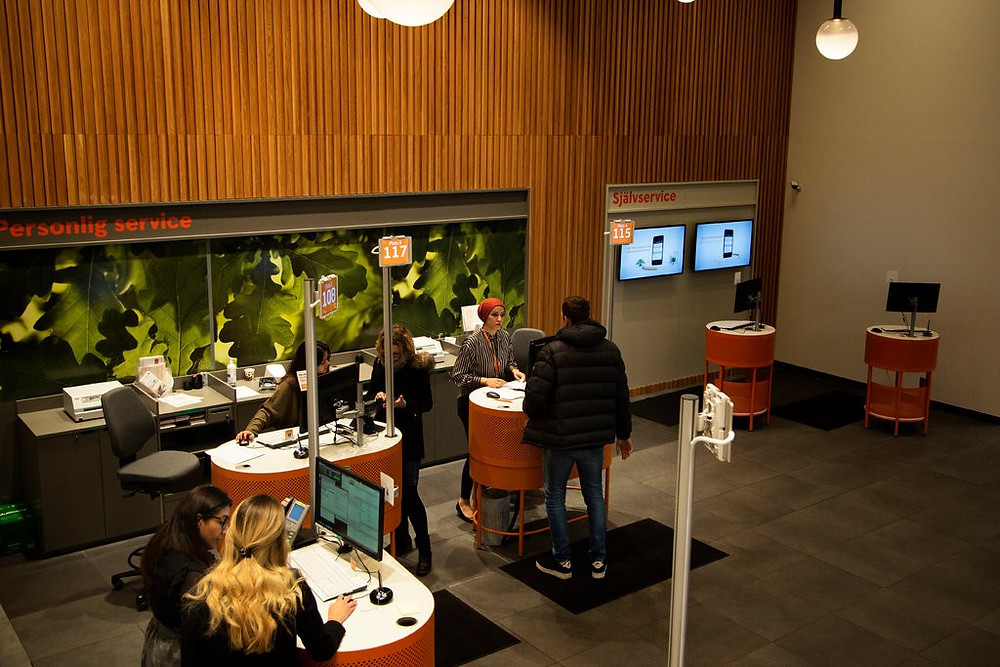 A reception area for clients at a Swedbank branch. Customers who wish to deposit or withdraw cash have to go around the corner to an office that still handles paper money and coins.CreditLoulou d'Aki for The New York Times