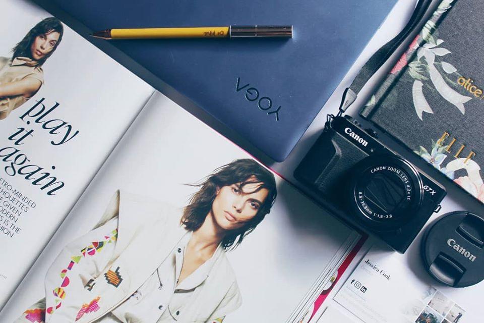 Flatlay canon camera, magazines and stationery