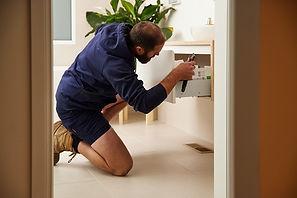 Plumber repairing fixture