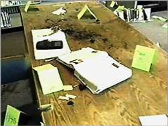 Columbine crime scene photo: library suicides burned table, Molotov cocktail Eric Harris Dylan Klebold