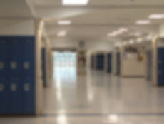 Columbine High interior corridor Rebels mascot blue lockers