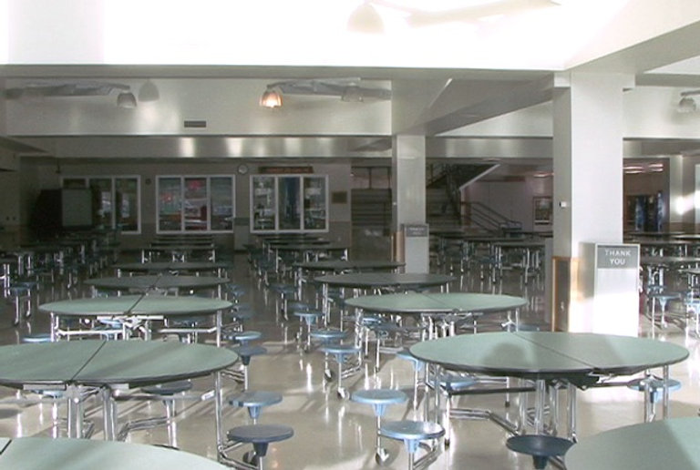 Columbine High interior cafeteria commons round tables