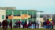 Columbine crime scene photo: exterior boarded library windows, cafeteria