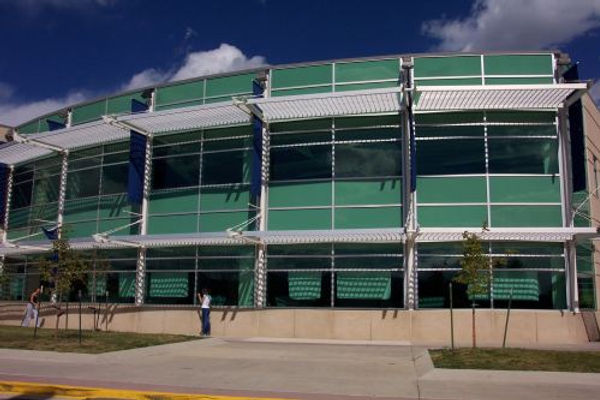 Columbine High exterior cafeteria library commons rounded green windows