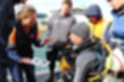 Renee Tigges briefing a trainee commercial diver prior to a mock IMS inspection.