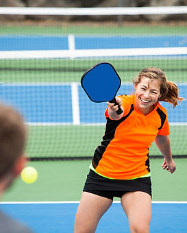 Female Pickleball player in action on an