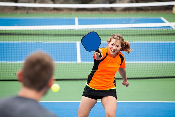 Female Pickleball player in action on an outside court.jpg