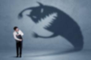 Business man afraid of his own shadow mo
