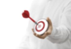 caucasian man holding a modern target wi