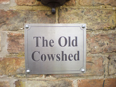 The Old Cowshed Sign