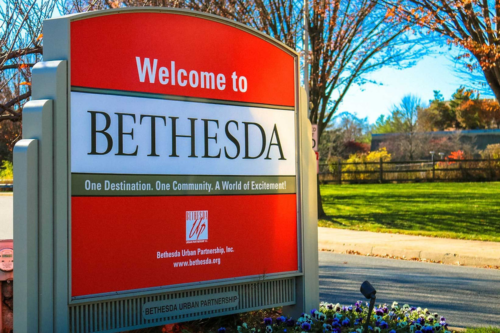 """A sign that reads """"Welcome to Bethesda. One Destination. One Community. A World of Excitement!"""""""