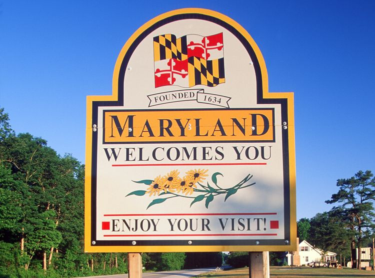 """A large road sign reading """"Maryland Welcomes You. Enjoy Your Visit!"""""""
