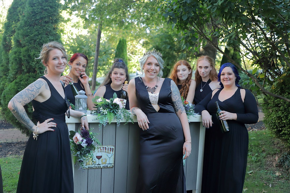 A bride and her bridesmaids aroud the bar in our cocktail garden.