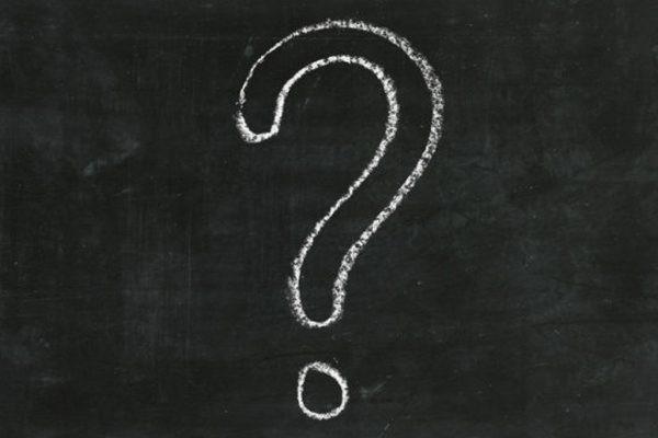 A question mark drawn on a chalkboard