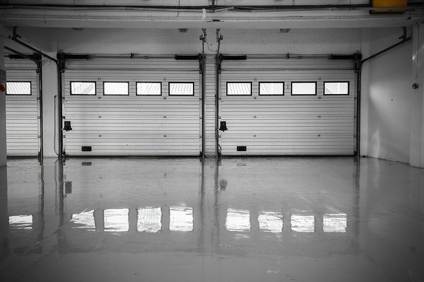an auto motor speedway garage, interior,