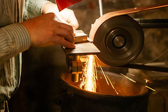 the hands of a locksmith grinding the wo