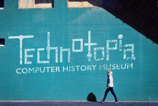The Technotopia logo displayed on a wall, possibly for use near the museum.