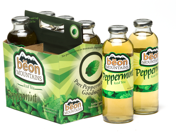 The Beon Mountains carrier, alongside several bottles to compliment the color of the tea.