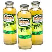Several bottles of Beon Mountains Iced Tea, showing the color of the drink as combined with the labeling.