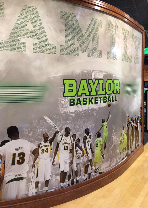 A photo of the mural installed in the locker room.