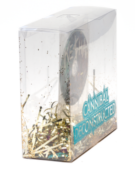 The album packaging from the side, showing how the CD floats above the glitter and costume elements.
