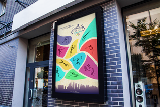 A promotional poster for the 2024 Doha Olympics, shown in a street setting.