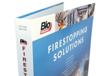 A close-up of the Firestopping Solutions binder, showing the binding and some of the smaller cover images.