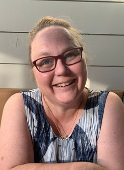 Sarah Headshot smile_edited_edited_edited.jpg