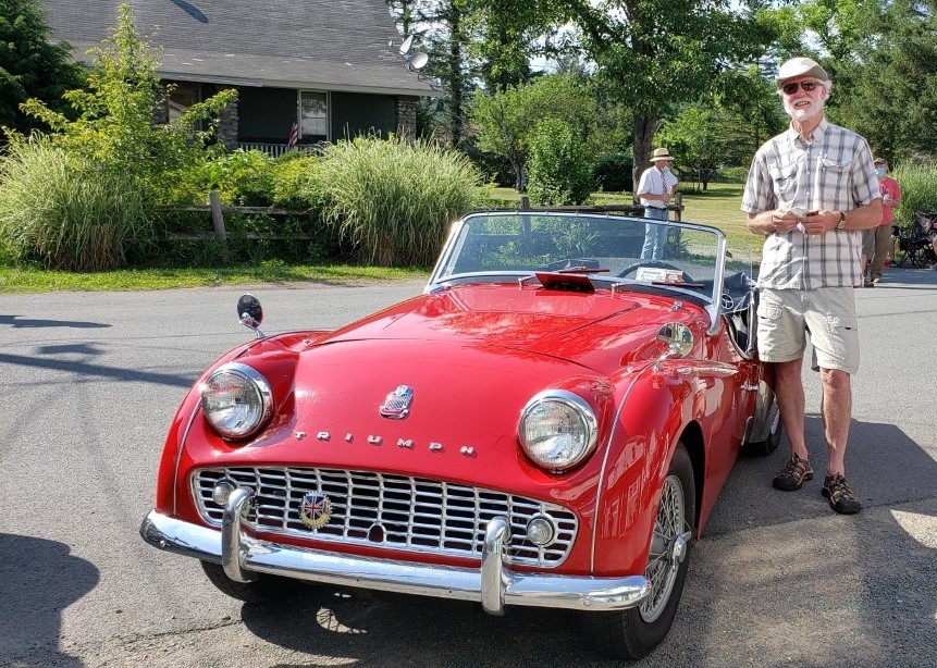 Bruce Bidwell stands near his 1959 triumph tr3 car. Lifestyles photo by Katie Collins.