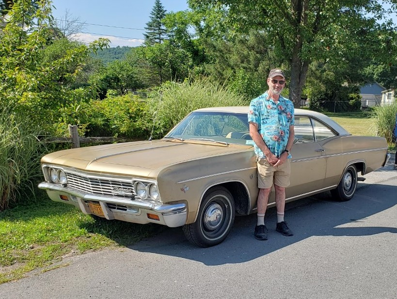Craig Smith stands near his 66 Chevy Impala Sandalwood. Lifestyles photo by Katie Collins.